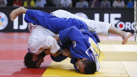 Japan's Hiroyuki Akimoto (R) fights with Georgia's Nugzari Tatalashvili (L) in their men's under 73kg bronze medal match at the Paris International Grand Slam judo tournament, France, February 6, 2016.  REUTERS/Charles Platiau TPX IMAGES OF THE DAY      (Newscom TagID: rtrlseven621572.jpg) [Photo via Newscom]