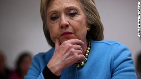 Democratic presidential candidate former Secretary of State Hillary Clinton pauses as she meets with employees at Velcro Companies on February 8, 2016 in Manchester, New Hampshire.