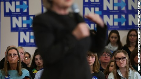 "DERRY, NH - FEBRUARY 03:  Supporters look on as democratic presidential candidate former Secretary of State Hillary Clinton speaks during a ""get out the vote"" event at Derry Boys and Girls Club on February 3, 2016 in Derry, New Hampshire.  With less than one week to go until the New Hampshire primaries, Hillary Clinton is campaigning throughout the state.  (Photo by Justin Sullivan/Getty Images)"