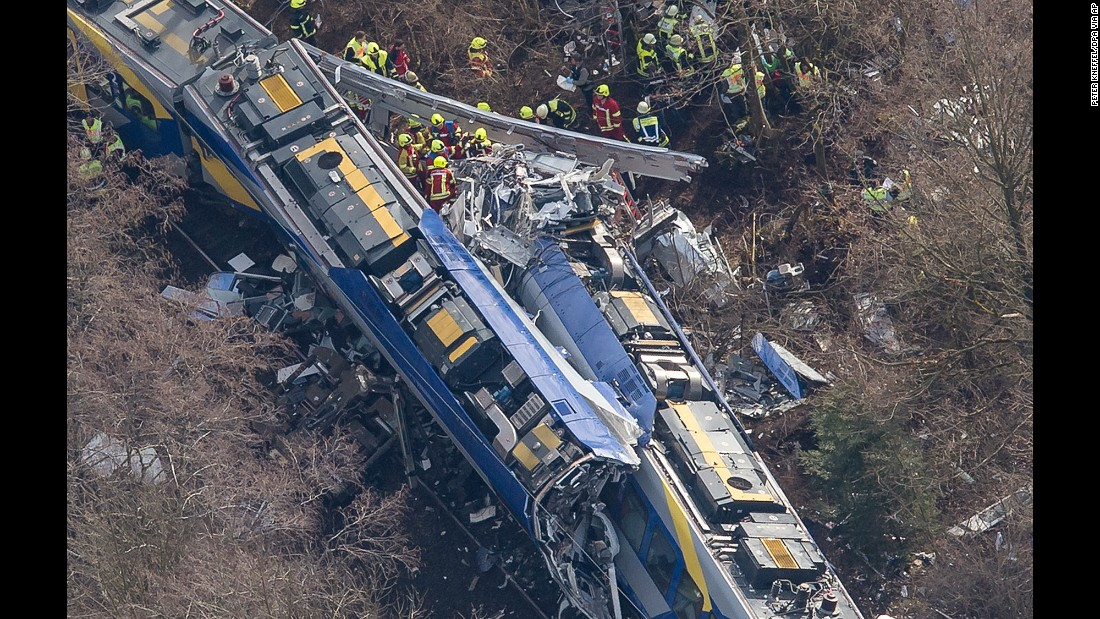 Rescue workers search the site of a deadly train accident near Bad Aibling, Germany, on Tuesday, February 9. Two trains collided in the southern state of Bavaria, police said.