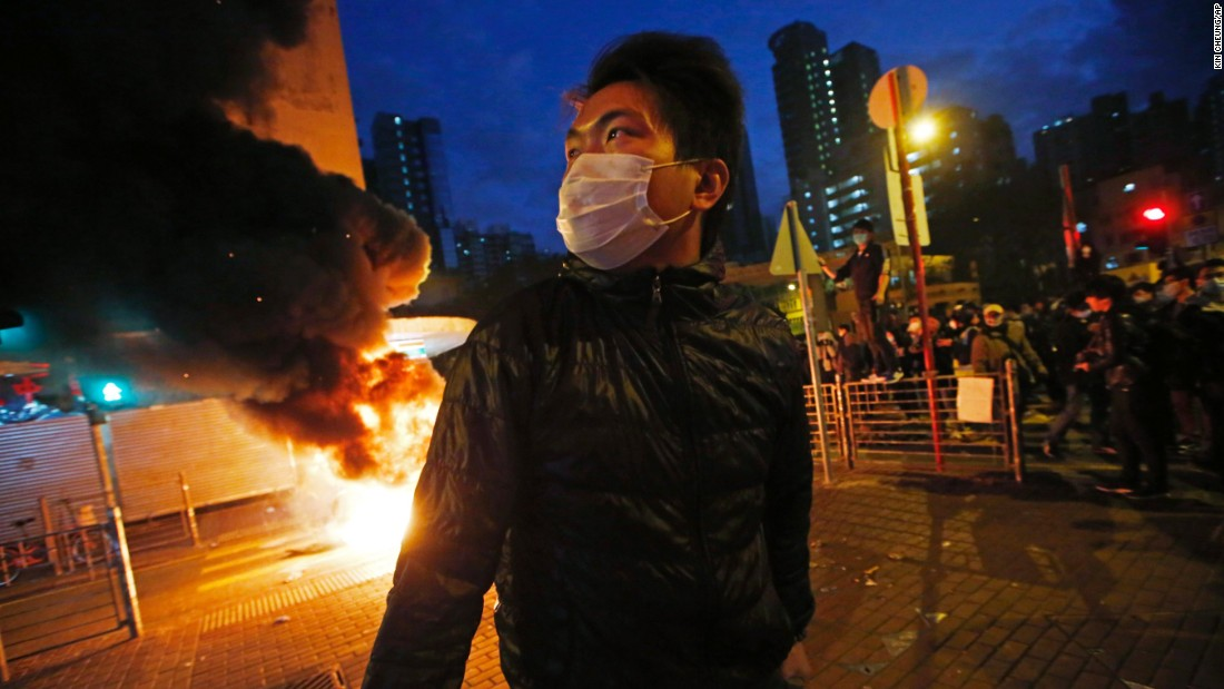Smoke rises as protesters set fires on a street in Mong Kok in the early hours of February 9.