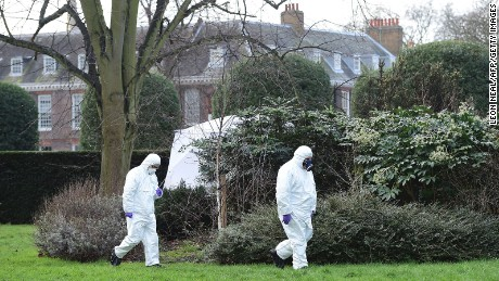 Forensics officers walk near the scene where a man set himself on fire in the park outside Kensington Palace in London on Tuesday, February 9.