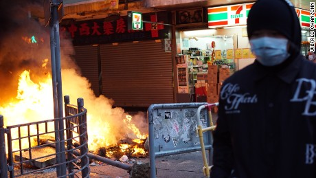 Protesters built fires in the middle of the street in Mong Kok, Hong Kong, on February 9.