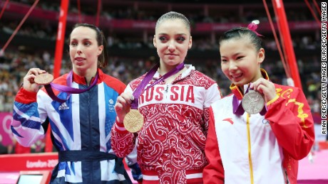 LONDON, ENGLAND - AUGUST 06:  (R-L) Silver medalist Kexin He of China, gold medalist Aliya Mustafina of Russia and bronze medalist Elizabeth Tweddle of Great Britain pose on the podium during the medal ceremony for the Artistic Gymnastics Women's Uneven Bars final on Day 10 of the London 2012 Olympic Games at North Greenwich Arena on August 6, 2012 in London, England.  (Photo by Ryan Pierse/Getty Images)