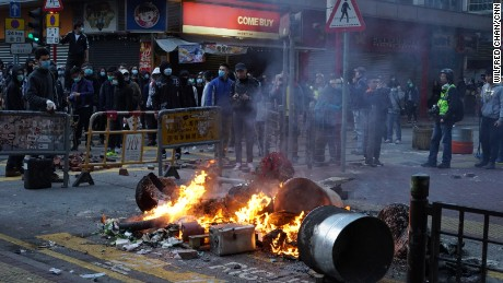 Fires lit by protesters burn at an intersection in one of Hong Kong's busiest shopping districts.