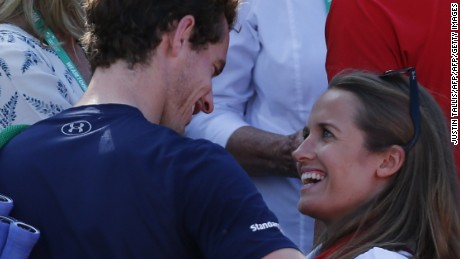Britain's Andy Murray celebrates with his wife Kim Sears after beating France's Gilles Simon in a Davis Cup world group quarter-finals singles tennis match at the Queen's Club in west London on July 19, 2015. Andy Murray clinched Great Britain's first Davis Cup semi-final berth for 34 years as the world number three's gritty victory against Gilles Simon gave his country an unassailable 3-1 lead.  AFP PHOTO / JUSTIN TALLIS        (Photo credit should read JUSTIN TALLIS/AFP/Getty Images)