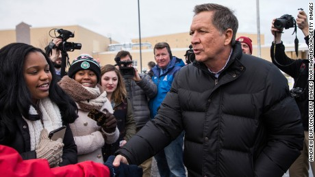 MANCHESTER, NH - FEBRUARY 09:  Republican presidential candidate Ohio Governor John Kasich shakes hands with voters outside Manchester High School, a voting location for the New Hampshire state primary, on February 9, 2016 in Manchester, New Hampshire. (Photo by Andrew Burton/Getty Images)