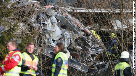 BAD AIBLING, GERMANY - FEBRUARY 09:  Rescue workers stand near the wreckage of two trains that collided head-on several hours before in Bavaria on February 9, 2016 near Bad Aibling, Germany. Authorities say at least four people are dead and over 150 injured in the collision between two trains of the Meridian local commuter train service that occurred at approximately 7 am.  (Photo by Alexander Hassenstein/Getty Images)