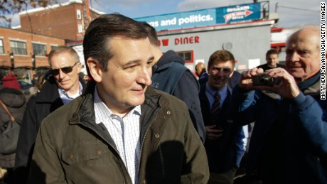 Republican presidential candidate Ted Cruz leaves a campaign stop on February 9, 2016 at the Red Arrow Diner in Manchester, New Hampshire.