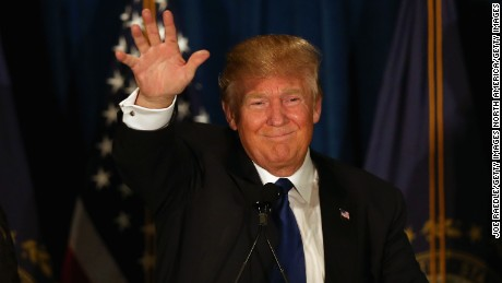 MANCHESTER, NH - FEBRUARY 09:  Republican presidential candidate Donald Trump waves to his supporters after Primary day at his election night watch party at the Executive Court Banquet facility on February 9, 2016 in Manchester, New Hampshire.  (Photo by Joe Raedle/Getty Images)