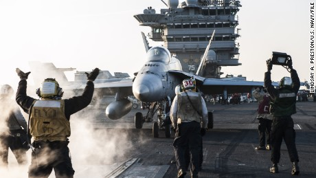 """160202-N-GK939-170 ARABIAN GULF (Feb. 2, 2016) Sailors direct an F/A-18C Hornet, assigned to the """"Rampagers"""" of Strike Fighter Squadron (VFA) 83, on the flight deck of aircraft carrier USS Harry S. Truman (CVN 75). Harry S. Truman Carrier Strike Group is deployed in support of Operation Inherent Resolve, maritime security operations, and theater security cooperation efforts in the U.S. 5th Fleet area of operations. (U.S. Navy photo by Mass Communication Specialist Seaman Lindsay A. Preston/Released)"""
