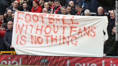 Liverpool fans hold a banner as they protest against the recently announced rise in ticket prices during the English Premier League football match between Liverpool and Sunderland at Anfield in Liverpool, northwest England, on February 6, 2016. / AFP / LINDSEY PARNABY / RESTRICTED TO EDITORIAL USE. No use with unauthorized audio, video, data, fixture lists, club/league logos or 'live' services. Online in-match use limited to 75 images, no video emulation. No use in betting, games or single club/league/player publications.  /         (Photo credit should read LINDSEY PARNABY/AFP/Getty Images)