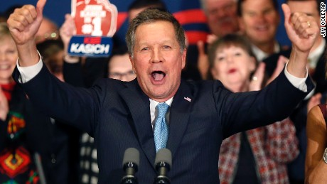 With his wife Karen at his side Republican presidential candidate Ohio Gov. John Kasich cheers with supporters Tuesday, Feb. 9, 2016, in Concord, N.H., at his primary night rally. (AP Photo/Jim Cole)