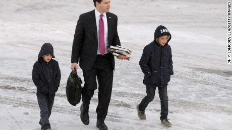 MANCHESTER, NH - FEBRUARY 10:  Republican presidential candidate Sen. Marco Rubio (R-FL) and his sons Anthony and Dominick walk across the tarmac before departing from Manchester-Boston Regional Airport February 10, 2016 in Manchester, New Hampshire. Rubio placed fifth in the New Hampshire primary, behind fellow GOP candidates Jeb Bush, John Kasich, Sen. Ted Cruz (R-TX) and Donald Trump, who swept away the competition with 35-percent of the vote.  (Photo by Chip Somodevilla/Getty Images)