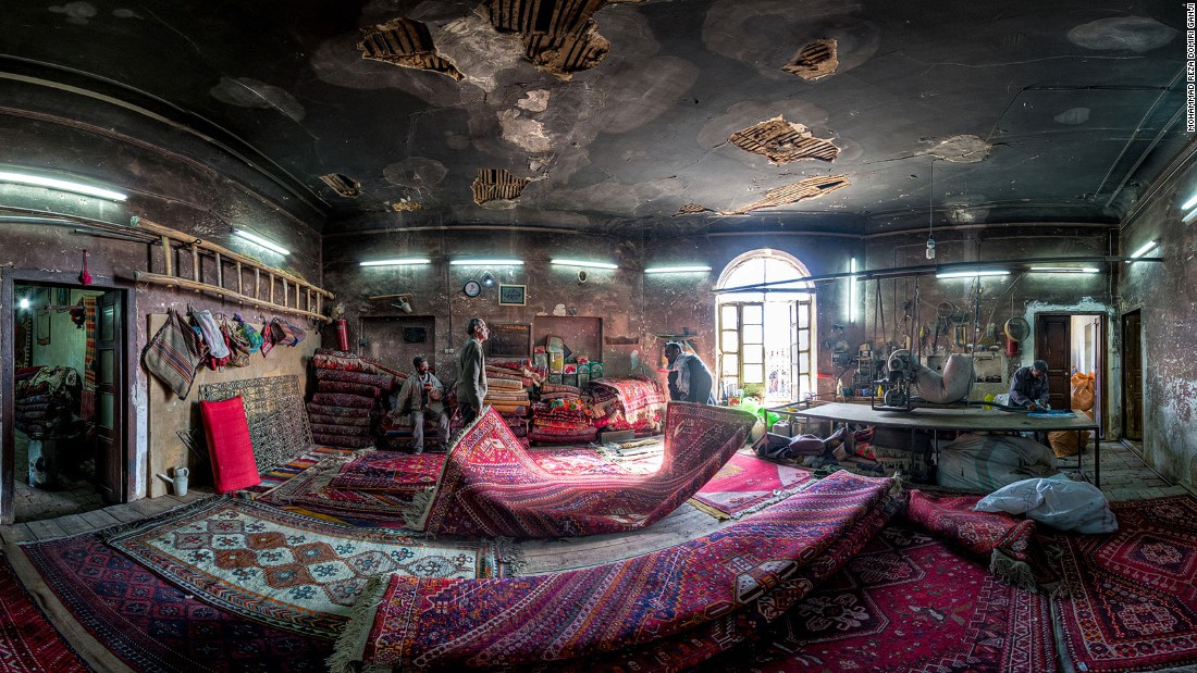 "Carpet-making is one of the oldest and most important industries in Iran, says Ganji. ""I tried to capture the spirit of life which exists in this workshop and its workers. Every carpet brought here to be repaired has a spirit too."""