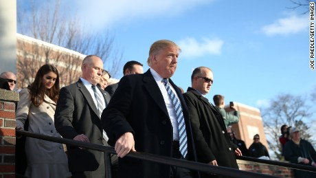 Republican presidential candidate Donald Trump visits a polling station as voters cast their primary day ballots on February 9, 2016 in Manchester, New Hampshire.