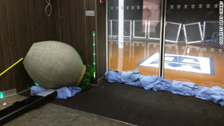 A vase is tipped over after Royal Caribbean's Anthem of the Seas hit rough weather.