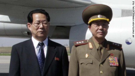 In this May 22, 2013 file photo, Kim Hyong Jun, deputy minister Foreign Affairs, Ri Yong Gil,  col. gen. of the Korean People's Army, pose before leaving Pyongyang Airport in North Korea for China.