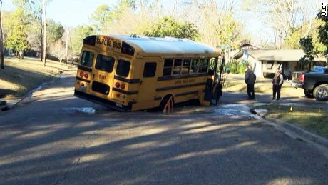Bus falls into sinkhole