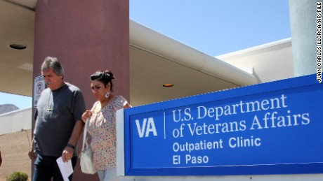 FILE - In this June 9, 2014 file photo, David and Marianne Trujillo exit the Vetarans Affairs facility in El Paso, Texas. In an analysis of six months of appointment data at 940 VA hospitals and clinics nationwide from September 2014 to February 2015, despite a nationwide push to lessen the wait times for veterans seeking health care, VA medical facilities across Texas have shown little to no sustained progress. The dilemma mirrors a trend across the country in which facilities are struggling to improve how often they meet the U.S. Department of Veterans Affairs' goal to have patients seen within 30 days. (AP Photo/Juan Carlos Llorca, File)