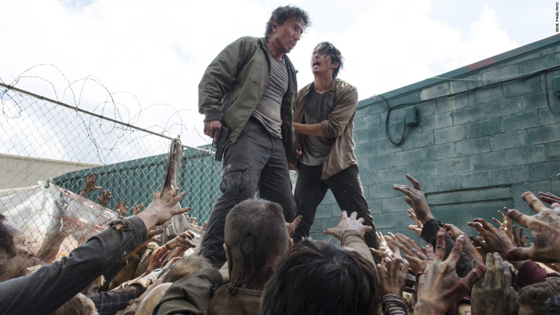 Fans were almost starting to warm up to Nicholas (Michael Traynor, left) by the time a gang of walkers devoured him in front of Glenn (Steven Yeun). Glenn managed to avoid the same fate by hiding under a garbage bin.