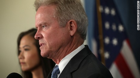 Former U.S. Sen. Jim Webb (D-VA) speaks as his wife Hong Le Webb listens during a news conference at the National Press Club October 20, 2015 in Washington, DC.
