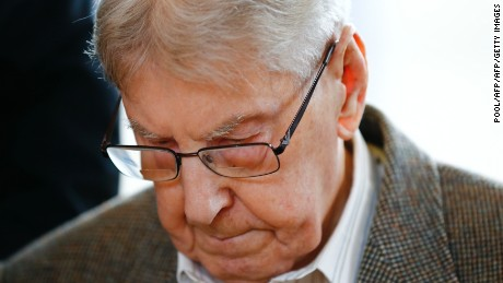 Former Auschwitz guard Reinhold Hanning, 94, arrives for his trial at the court in Detmold, Germany.