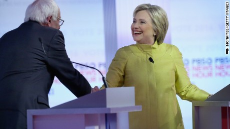 Democratic presidential candidates Senator Bernie Sanders (L) and Hillary Clinton participate in the PBS NewsHour Democratic presidential candidate debate at the University of Wisconsin-Milwaukee on February 11, 2016 in Milwaukee, Wisconsin.