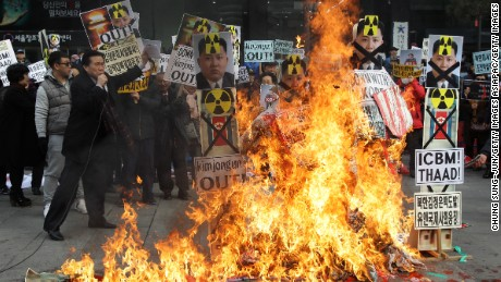 SEOUL, SOUTH KOREA - FEBRUARY 11:  South Korean protesters burn an effigy of North Korea leader Kim Jong-Un during an anti-North Korea rally on February 11, 2016 in Seoul, South Korea. South Korea announced on February 10, 2016 that the country would close an industrial complex jointly ran with North Korea, as the strongest response for North's recent nuclear test and rocket launch.  (Photo by Chung Sung-Jun/Getty Images)