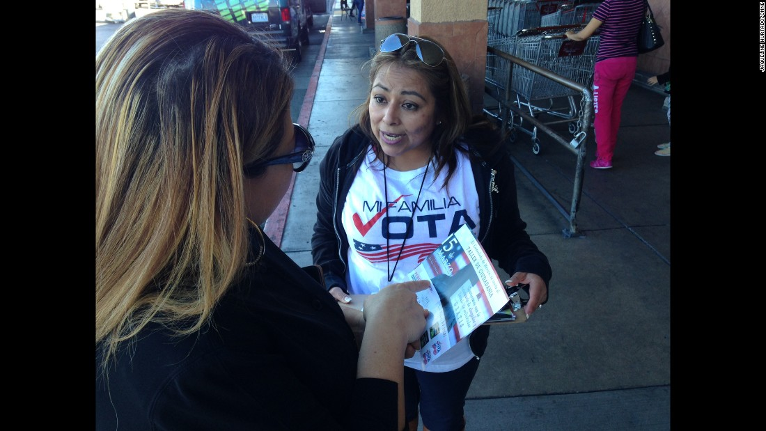 The nonpartisan organization Mi Familia Vota campaigns outside supermarkets in Las Vegas in a drive to register more Latinos to vote.