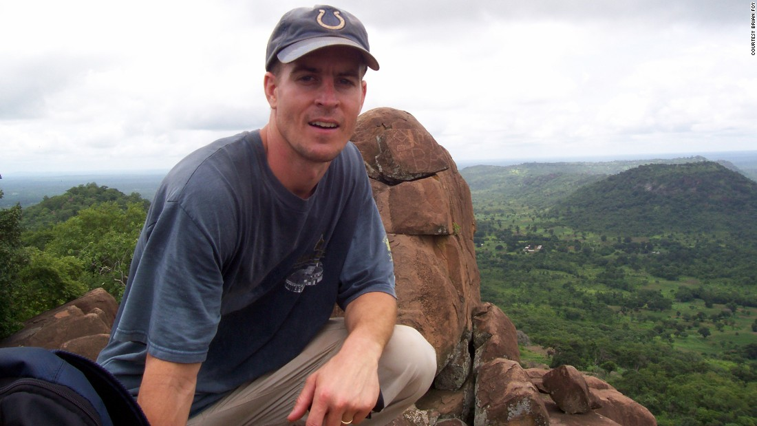 Microbiologist Brian Foy poses on a hillside above the villages of Ibel and Ndebou in southeastern Senegal in the summer of 2008. Senegal is a small country in West Africa.