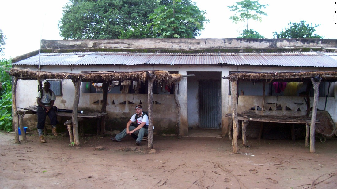 African researcher Massamba Sylla, left, and graduate student Kevin Kobylinski visit a villager's home in Ibel, Senegal.