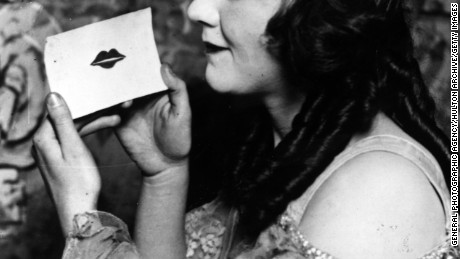 circa 1925:  Irene Regan with a Valentine card imprinted with a lipstick kiss.  (Photo by General Photographic Agency/Getty Images)