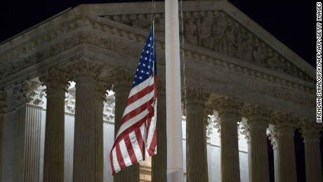A flag at the US Supreme Court is lowered to half staff February 13, 2016 in Washington, DC, following the announcement of the death of Supreme Court Justice Antonin Scalia.  Scalia, a fiery conservative who helped shape American legal thought, was first appointed to the highest court in the land in 1986 by President Ronald Reagan, making him the first Italian-American to serve there. Scalia was 79.   / AFP / Brendan Smialowski        (Photo credit should read BRENDAN SMIALOWSKI/AFP/Getty Images)