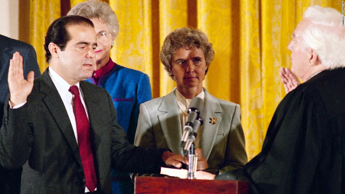 Retiring Chief Justice Warren Burger, right, administers an oath to Associate Justice Antonin Scalia, as Scalia's wife, Maureen, holds the Bible on September 26, 1986. Scalia was the 103rd person to sit on the court.