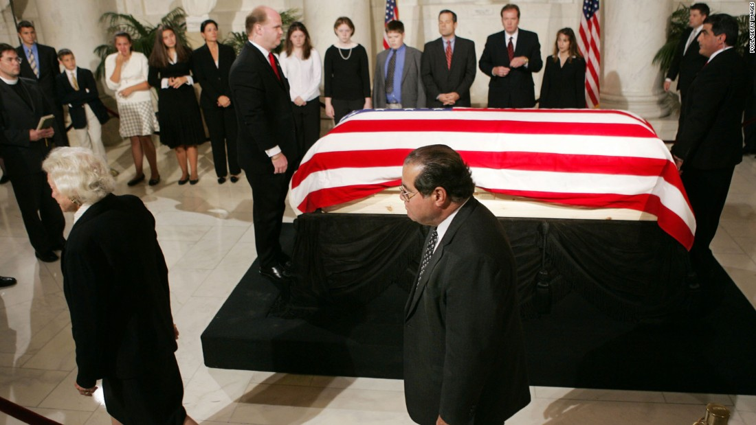 The casket of Chief Justice William H. Rehnquist lies in the Great Hall of the U.S. Supreme Court as  Scalia and Sandra Day O'Connor, left, walk past on September 6, 2005, in Washington.