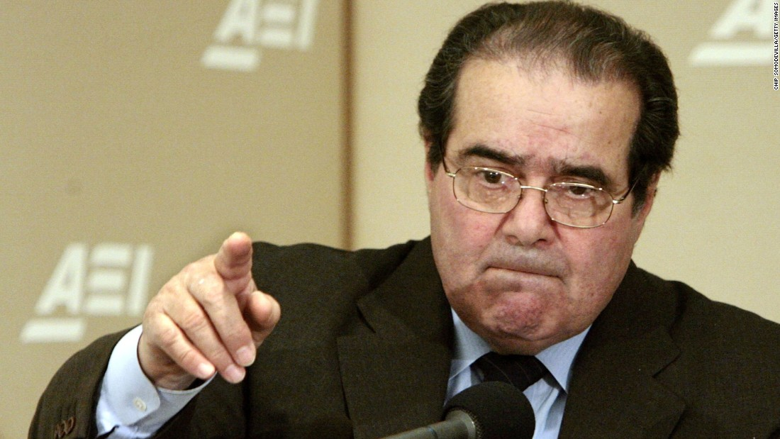 """Scalia calls on people during a question-and-answer period at the American Enterprise Institute on February 21, 2006, in Washington. Scalia delivered the keynote address about foreign law and the debate about how it is used in American Law during the seminar called """"Outsourcing Of American Law."""""""