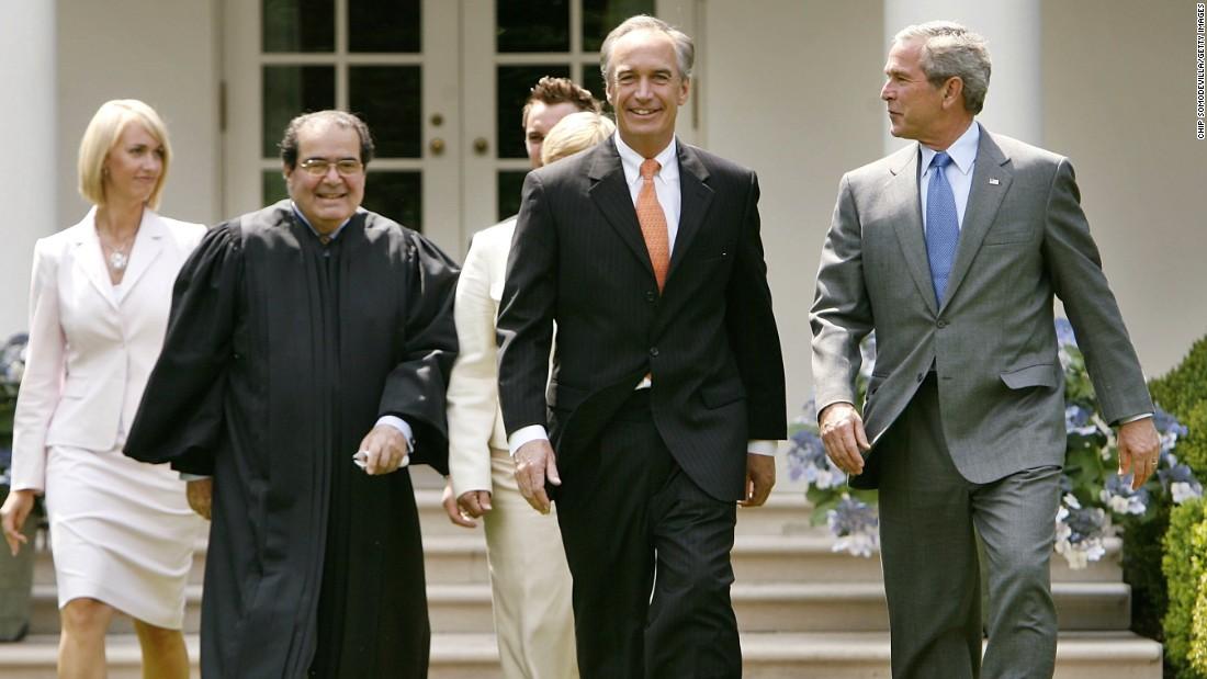 Heather Myklegard, Scalia, Dirk Kempthorne and U.S. President George W. Bush walk through the Rose Garden before Kempthorne is sworn in as the new interior secretary at White House on June 7, 2006, in Washington.