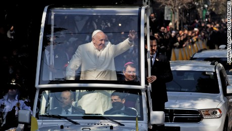 Pope Francis waves at the crowd from the popemobile on his way to take a helicopter to Ecatepec --a rough, crime-plagued Mexico City suburb-- where he will celebrate an open-air mass, in Mexico City on February 14, 2016. Pope Francis has chosen to visit some of Mexico's most troubled regions during his five-day trip to the world's second most populous Catholic country.    AFP PHOTO / DIANA ULLOA / AFP / DIANA ULLOA        (Photo credit should read DIANA ULLOA/AFP/Getty Images)