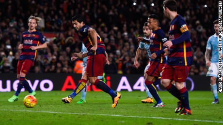 Messi has sidefooted his pass to  Suarez  from the penalty spot for the Uruguayan to complete his hat-trick with a low shot.