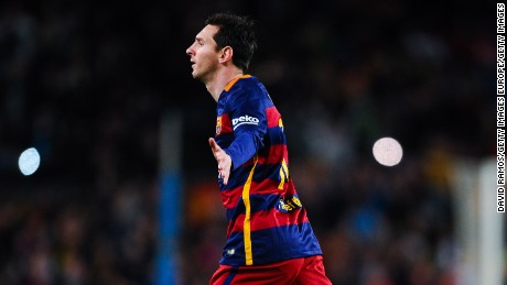 Messi celebrates after putting Barcelona ahead in the Nou Camp with a superb free kick.