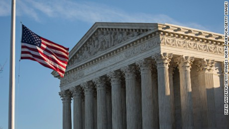WASHINGTON, DC - FEBRUARY 14:  An American flag flies at half mast following the death of Supreme Court Justice Antonin Scalia at the U.S. Supreme Court, February 14, 2016 in Washington, DC. Supreme Court Justice Antonin Scalia was at a Texas Ranch Saturday morning when he died at the age of 79. (Drew Angerer/Getty Images)