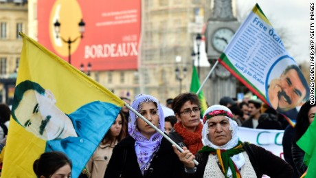 People wave flags with the portrait of the jailed leader of the Kurdistan Workers Party (PKK) Abdullah Ocalan during a demonstration in Bordeaux on January 23, 2016 called by associations for the defence of the Kurdish people and the 'Mouvement de la Paix' to denounce Turkish operations in southeast Turkey. / AFP / GEORGES GOBETGEORGES GOBET/AFP/Getty Images