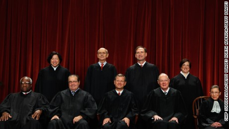WASHINGTON - OCTOBER 08:  U.S. Supreme Court members (first row L-R) Associate Justice Clarence Thomas, Associate Justice Antonin Scalia, Chief Justice John Roberts, Associate Justice Anthony Kennedy, Associate Justice Ruth Bader Ginsburg, (back row L-R) Associate Justice Sonia Sotomayor, Associate Justice Stephen Breyer, Associate Justice Samuel Alito and Associate Justice Elena Kagan pose for photographs in the East Conference Room at the Supreme Court building October 8, 2010 in Washington, DC. This is the first time in history that three women are simultaneously serving on the court.  (Photo by Chip Somodevilla/Getty Images)