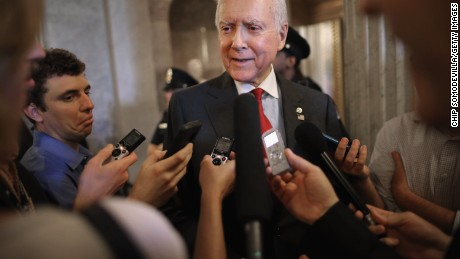 Sen. Orrin Hatch (R-UT) (C) talks with reporters after leaving the Senate floor at the U.S. Capitol May 18, 2015 in Washington, DC.