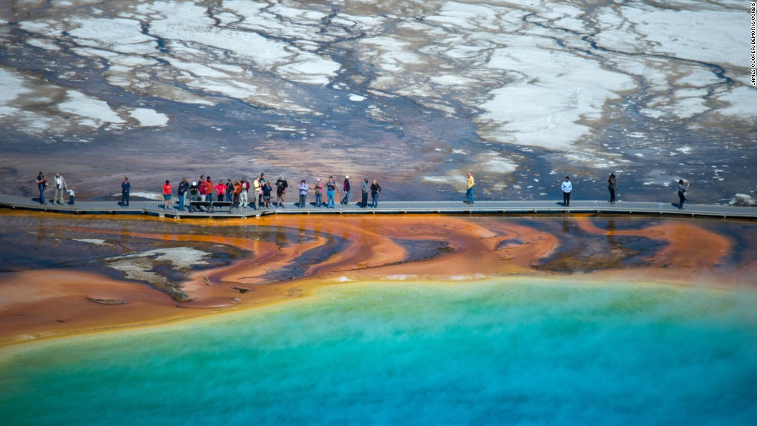 "<a href=""http://www.cnn.com/2013/08/15/travel/yellowstone-summer-in-the-park/"">Yellowstone National Park</a> was the world's first national park when it was created in 1872. Barely anyone could get there until the railroads connected people to the park in the 1880s.  More than 4 million people visited last year, often walking the Midway Geyser Basin boardwalk to see the Grand Prismatic geothermal pool. Yellowstone is home to about half of the world's geysers."