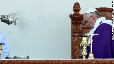 Pope Francis celebrates mass at the Venustiano Carranza stadium in Morelia, Michoacan State, Mexico on February 16, 2016. Pope Francis arrived in Mexico's troublesome western state of Michoacan, where the cult-like Knights Templar drug cartel and its pseudo-messianic leader terrorized the population until farmers revolted against them.   AFP PHOTO/ALFREDO ESTRELLA / AFP / ALFREDO ESTRELLA        (Photo credit should read ALFREDO ESTRELLA/AFP/Getty Images)