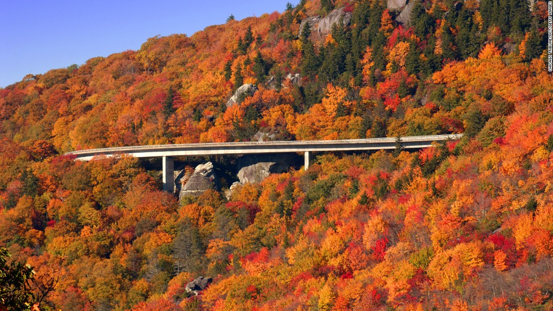 """The Blue Ridge Parkway tops  <a href=""""http://www.cnn.com/specials/travel/nps-100"""">National Park Service</a>'s list of most-visited sites in 2015, drawing more than 15 million visits. Fall foliage on the parkway's Linn Cove Viaduct in North Carolina is shown here. Click through the gallery to see the nine other most popular sites."""