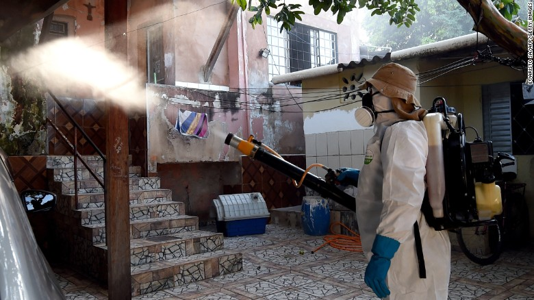 """A health worker fumigates an area in Gama, Brazil, to combat the Aedes aegypti mosquito on Wednesday, February 17. The mosquito carries the <a href=""""http://www.cnn.com/specials/health/zika"""" target=""""_blank"""">Zika virus,</a> which has suspected links to birth defects in newborn children. The World Health Organization expects the Zika outbreak to spread to <a href=""""http://www.cnn.com/2016/01/25/health/who-zika-virus-americas/index.html"""" target=""""_blank"""">almost every country in the Americas.</a>"""