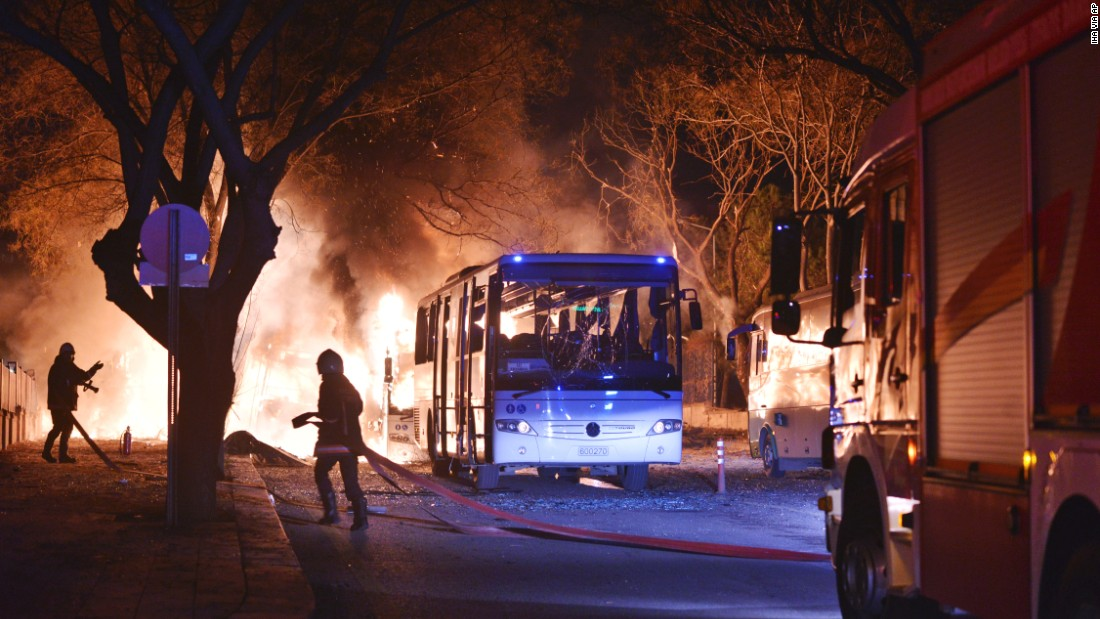 Firefighters work at the scene of a deadly explosion in Ankara, Turkey, on Wednesday, February 17. The explosion hit three military vehicles and a private vehicle near Turkish parliament buildings, reported Turkey's semiofficial Anadolu news agency.